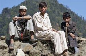 Young villagers look on in Ath Maqam, in the Neelum Valley, Pakistan, October 19, 2005